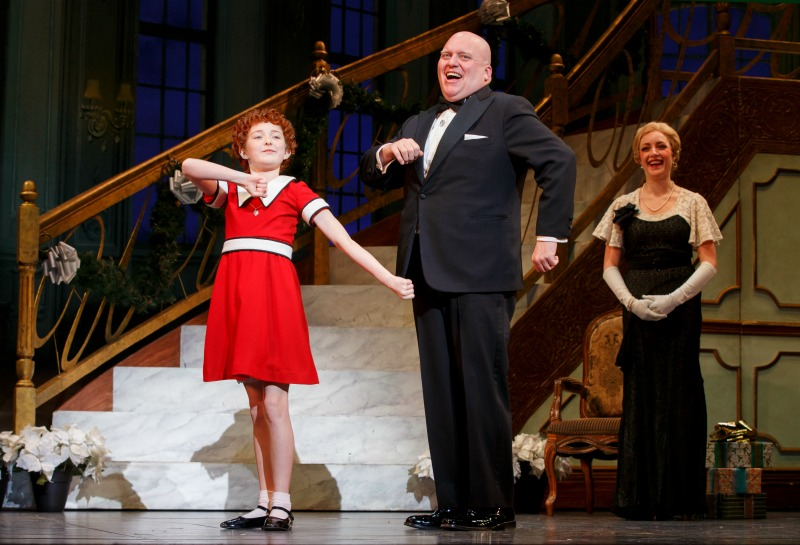 "Photo Credit: ©JOAN MARCUS Heidi Gray as Annie, Gilgamesh Taggettas Oliver Warbucks and Chloe Tisoas Grace Farrell in ""I Don't Need Anything but You"""